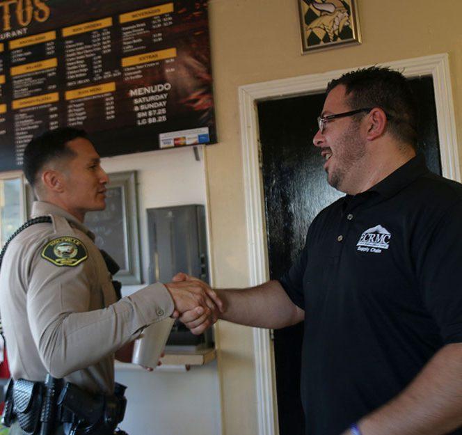 An Imperial County Sheriff's Deputy Greets Jerry Cerros propietor of Los Cerritos