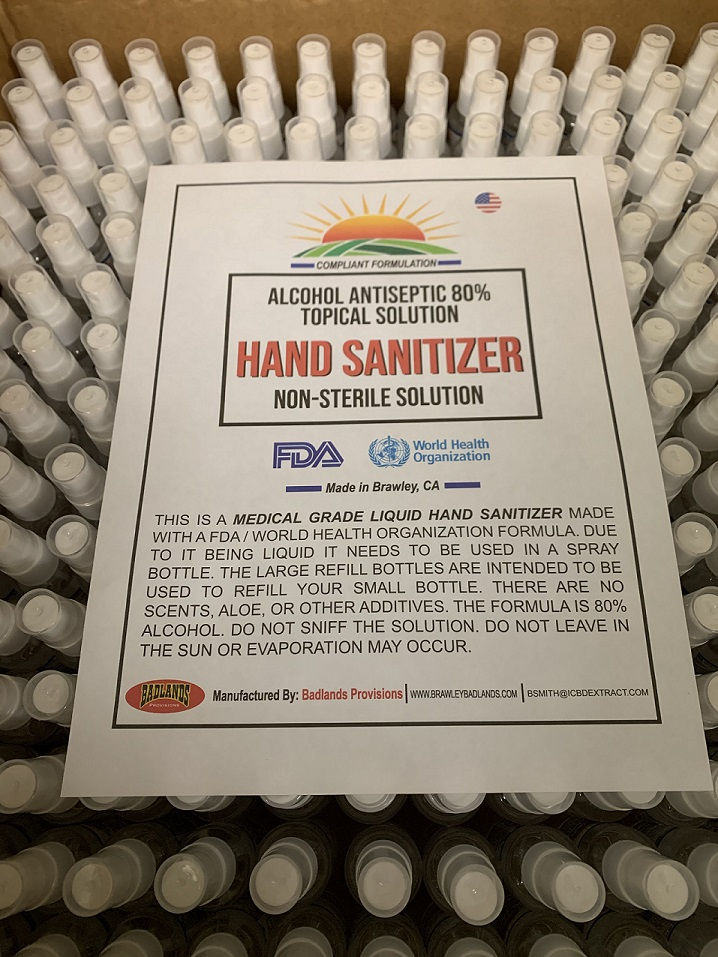 A box of small spray bottles of hand sanitizer await packing and shipment from Badlands Provisions in Brawley.