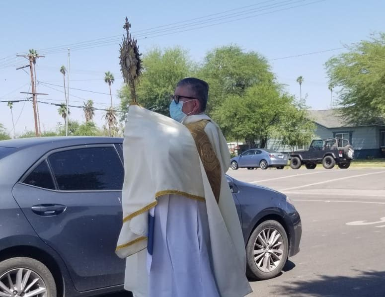 Father Moreno Feeds his Flock in Drive-By Blessings